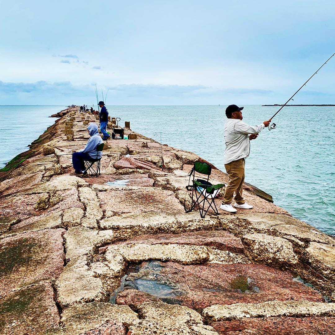 Fishing  off the jetty is quite a popular #sport here in South Padre Island.#fis…